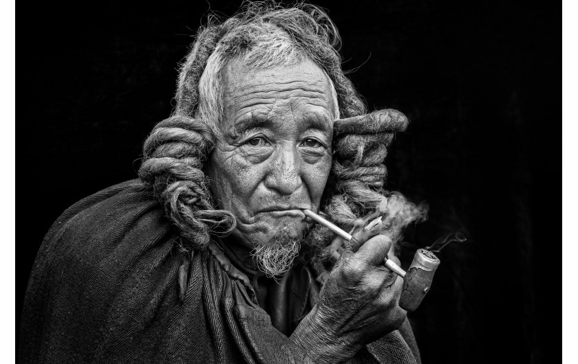 Xuejun Xia, YI ETHNIC ELDER, III miejsce w kategorii Fascinating faces and characters Siena International Photo Awards 2018